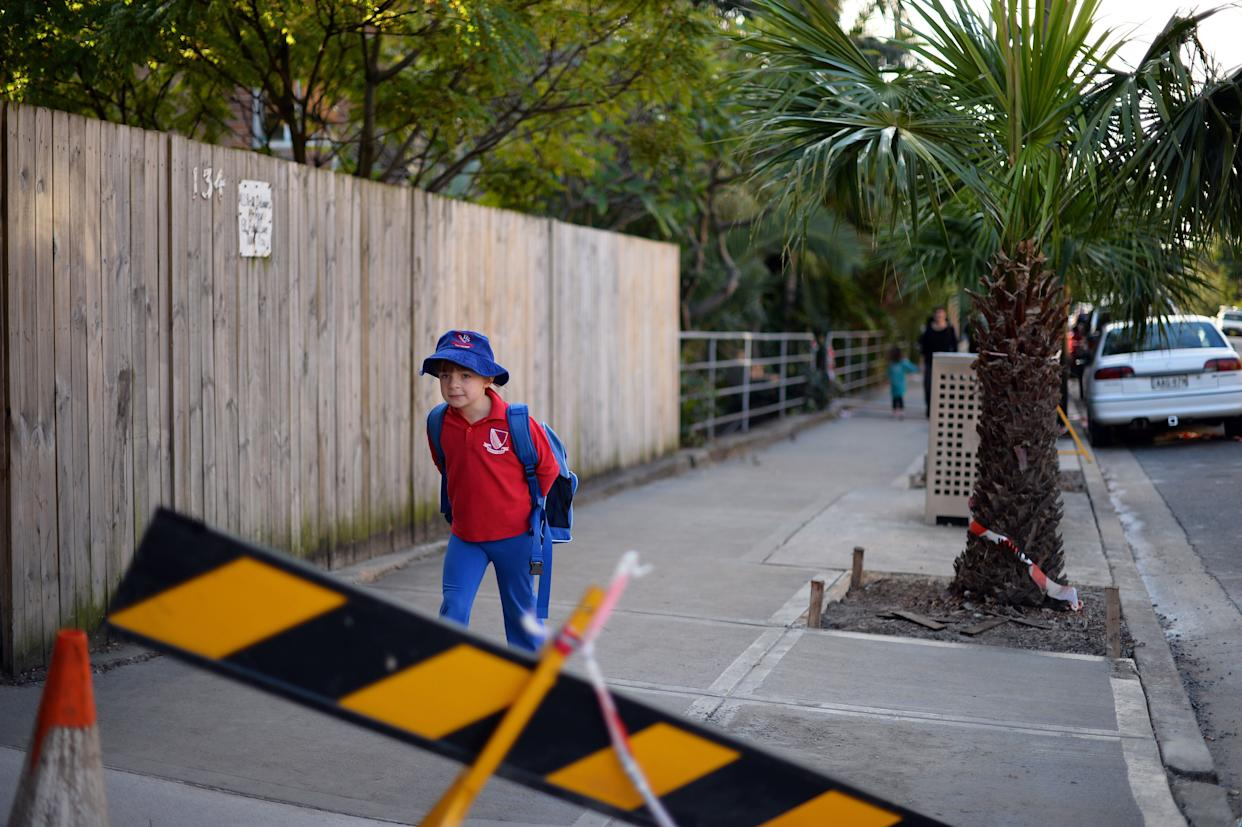 Frances McMillan, 6, walks to school in the Coogee suburb of Sydney, Australia, on June 17, 2013.