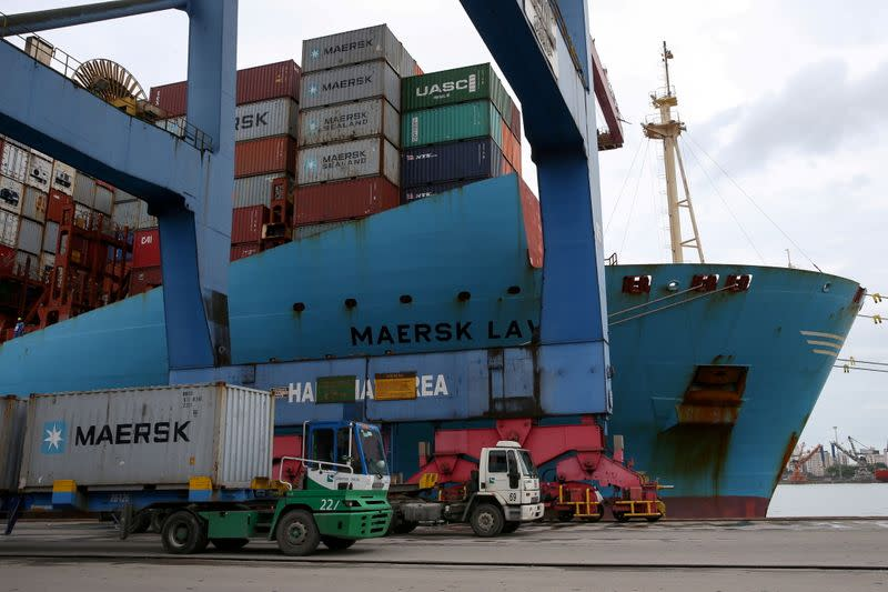 FILE PHOTO: A Maersk ship and containers are seen at the Port of Santos