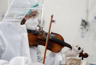 HOLD FOR STORY SLUGGED TUNISIA VIRUS OUTBREAK - Dr. Mohamed Salah Siala plays violin for patients of the COVID wards of the Hedi Chaker hospital in Sfax, eastern Tunisia. (AP Photo/str)