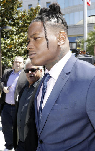San Francisco 49ers linebacker Reuben Foster leaves the Santa Clara County Superior Court after a preliminary hearing stemming from domestic violence accusations against him, Thursday, May 17, 2018, in San Jose, Calif. Foster's ex-girlfriend, Elissa Ennis, recanted allegations Thursday that Foster physically assaulted her. She testified that she lied to authorities about the domestic assault to get back at Foster for breaking up with her. (AP Photo/Marcio Jose Sanchez)
