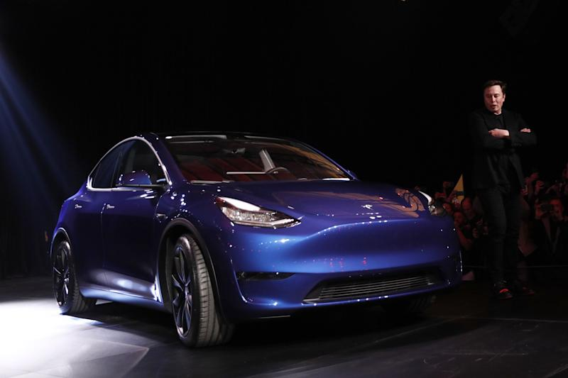 Elon Musk, co-founder and chief executive officer of Tesla Inc., speaks during an unveiling event for the Tesla Model Y crossover electric vehicle in Hawthorne, California, U.S., on Friday, March 15, 2019. Musk said the cheaper electric crossover sports utility vehicle (SUV) will be available from the spring of 2021. The vehicle's price will start at $39,000, a longer-range version will cost $47,000. Photographer: Patrick T. Fallon/Bloomberg via Getty Images
