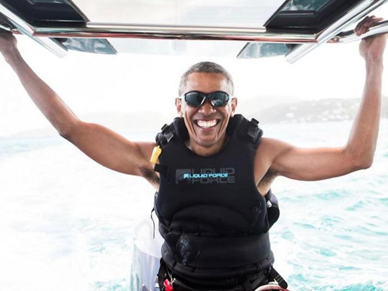 Mr Obama is all smiles during a vacation with his wife and business magnate Richard Branson (Jack Brockway/Virgin)