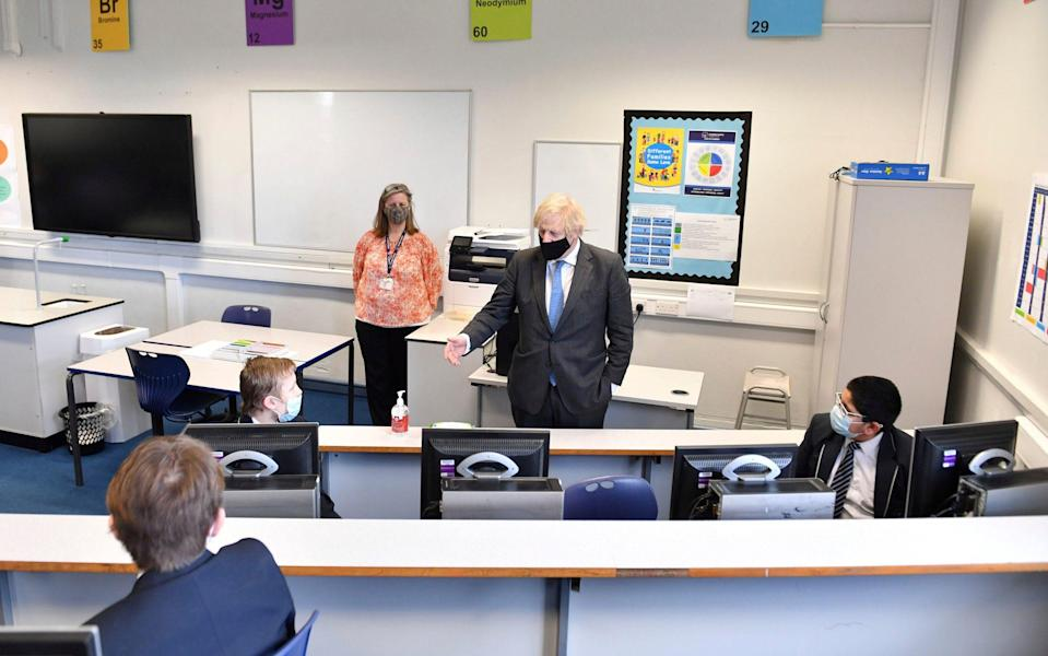 Prime Minister Boris Johnson, speaks with Year 7 students - Anthony Devlin/Pool AFP