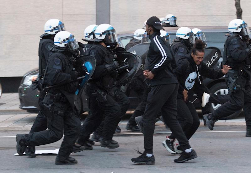 Police push back protesters during a demonstration on May 31, 2020 calling for justice in the death of George Floyd and victims of police brutality in Montreal. (Photo: Graham Hughes/CANADIAN PRESS)