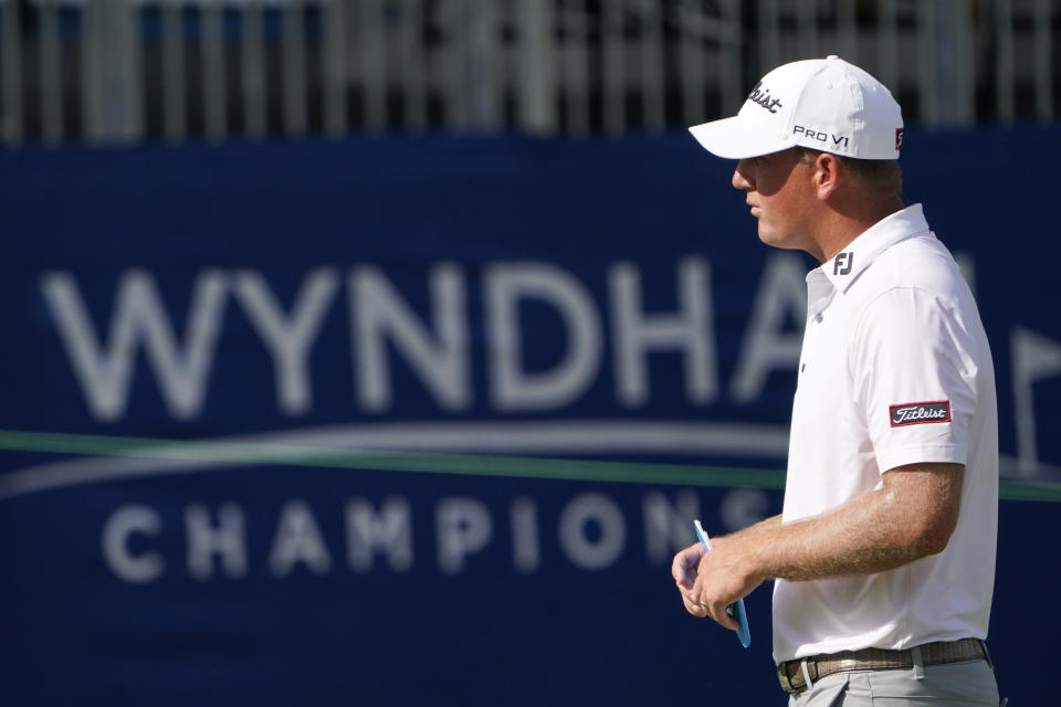Tom Hoge walks across the 18th green after finishing his opening round of the Wyndham Championship golf tournament at Sedgefield Country Club on Thursday, Aug. 13, 2020, in Greensboro, N.C. (AP Photo/Chris Carlson)