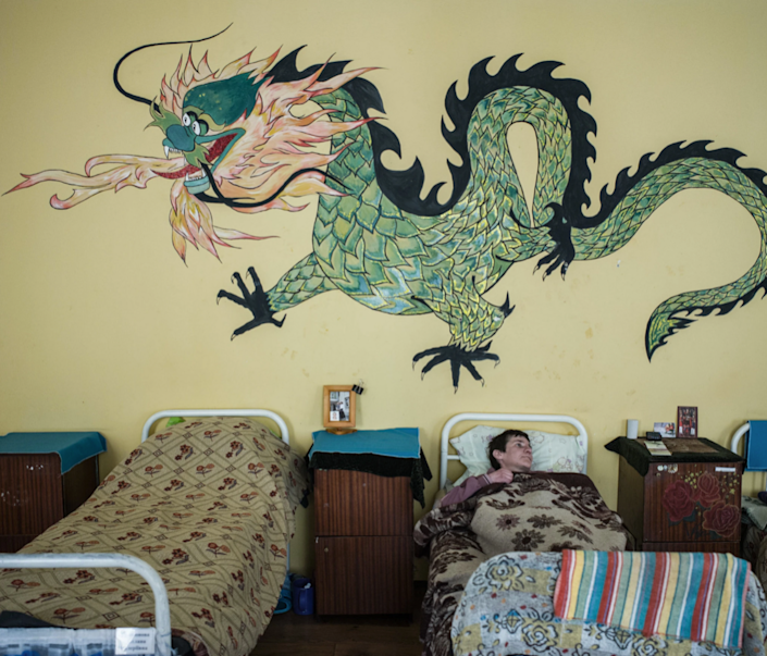 A fantastical green dragon adorns the wall of this Ukrainian women's facility.