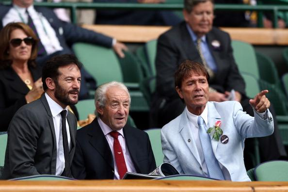 Jason Isaacs, Eric Isaacs and Sir Cliff Richard sit in the Royal Box on day ten of the Wimbledon Lawn Tennis Championships at the All England Lawn Tennis and Croquet Club on July 5, 2012 in London, England. (Photo by Paul Gilham/Getty Images)