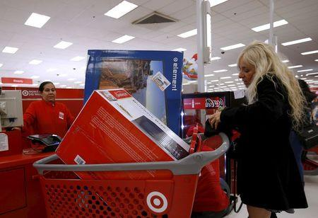 Nancy Villagomez pays for her purchases during Black Friday Shopping at a Target store in Chicago