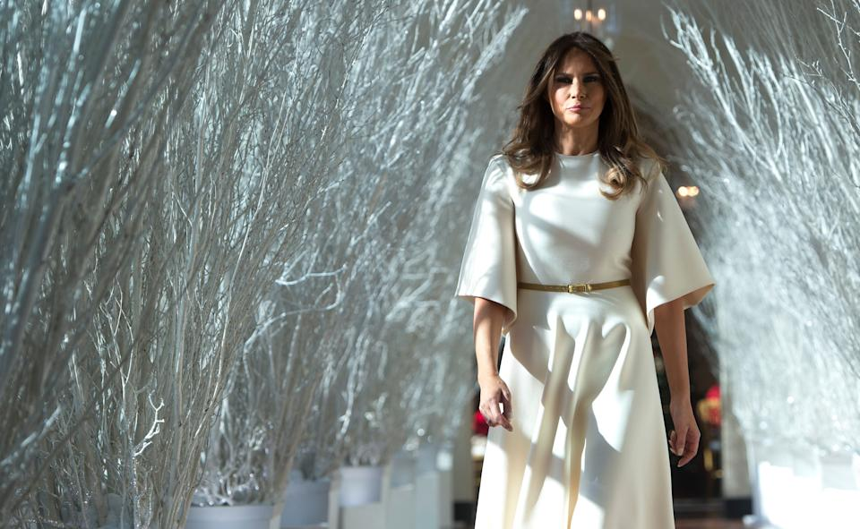 US First Lady Melania Trump walks through Christmas decorations in the East Wing as she tours holiday decorations at the White House in Washington, DC, on November 27, 2017. (Photo by SAUL LOEB / AFP) (Photo by SAUL LOEB/AFP via Getty Images) (Photo: SAUL LOEB via Getty Images)