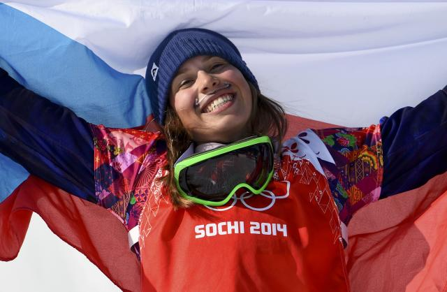 First placed Samkova of the Czech Republic celebrates after the women's snowboard cross finals at the 2014 Sochi Winter Olympic Games in Rosa Khutor