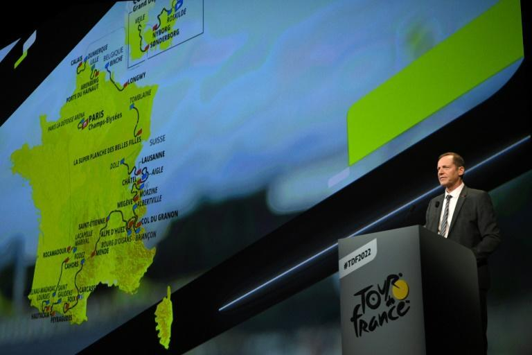 Tour de France general director Christian Prudhomme with the race route for 2022 (AFP/Anne-Christine POUJOULAT)