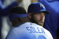 Kansas City Royals starting pitcher Danny Duffy is congratulated by Jorge Soler in the dugout after Duffy got his 1,000 career strikeout during the fourth inning of a baseball game against the Tampa Bay Rays Monday, April 19, 2021, in Kansas City, Mo. (AP Photo/Charlie Riedel)