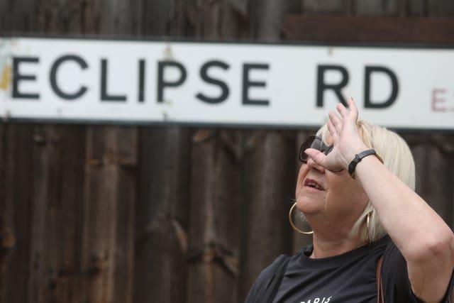 Someone checks out the partial eclipse