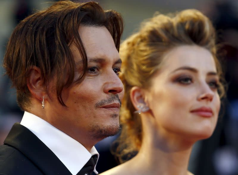 """FILE PHOTO: Actress Amber Heard and her husband Johnny Depp attend the red carpet event for the movie """"The Danish Girl"""" at the 72nd Venice Film Festival"""