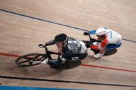 Sam Webster of Team New Zealand, left, and Sebastien Vigier of Team France compete during the track cycling men's sprint at the 2020 Summer Olympics, Thursday, Aug. 5, 2021, in Izu, Japan. (AP Photo/Thibault Camus)