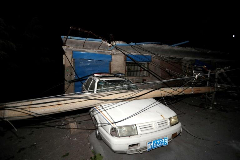 A car was crushed by a pole near the site of the explosion at the Henan Coal Gas Group factory in Yima city