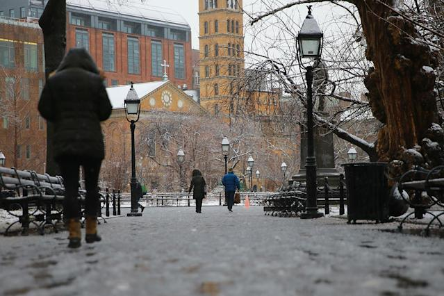 <p>A woman walks through Washington Square Park in New York City as snow turns to rain as the second storm in week hits the northeast on March 7, 2018. (Photo: Gordon Donovan/Yahoo News) </p>