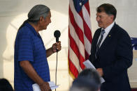 Russell Eagle Bear, a Rosebud Sioux tribal official, left, introduces Sen. Mike Rounds, R-S.D., during a ceremony at the U.S. Army's Carlisle Barracks, in Carlisle, Pa., Wednesday, July 14, 2021. The disinterred remains of nine Native American children who died more than a century ago while attending a government-run school in Pennsylvania were headed home to Rosebud Sioux tribal lands in South Dakota on Wednesday after a ceremony returning them to relatives. (AP Photo/Matt Rourke)