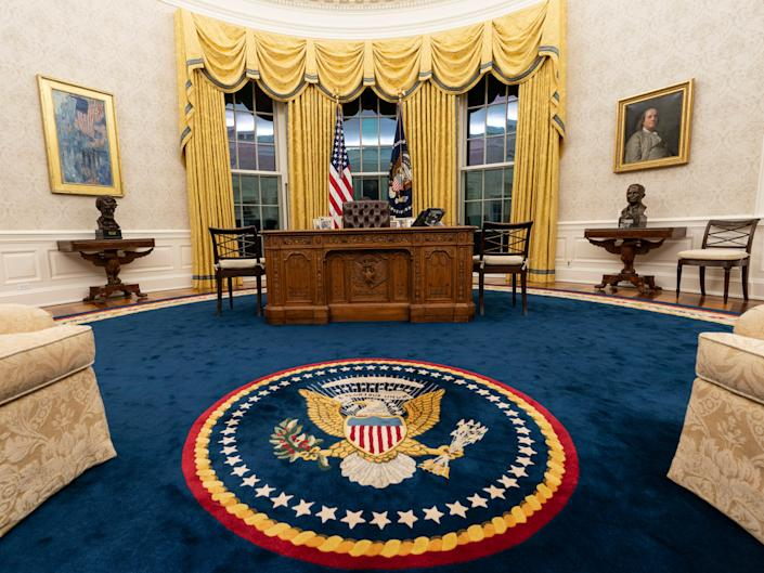 Darker curtains and deeper blue rug were put in the Oval Office of the White House for Joe Biden's administrationAP