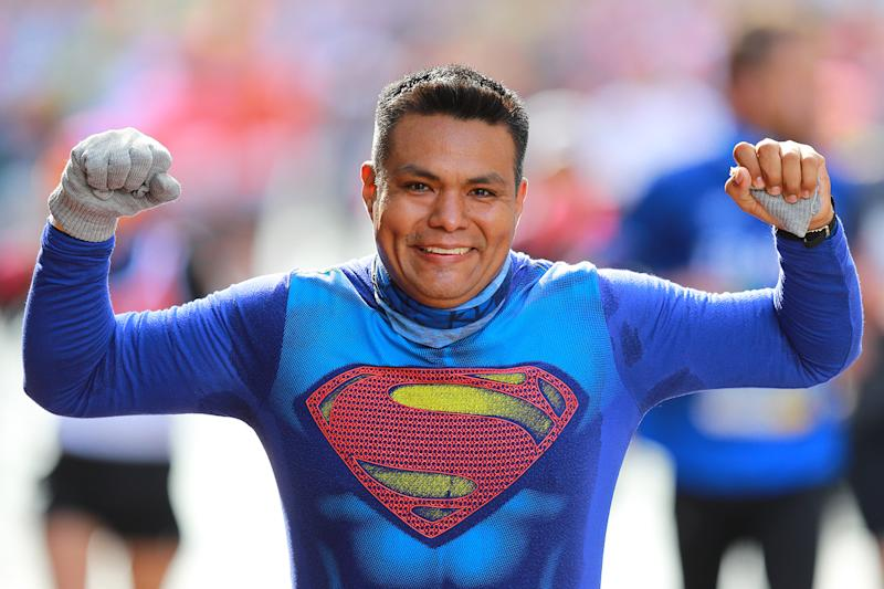A runner wears a Superman costume while participating in the 2019 New York City Marathon. (Photo: Gordon Donovan/Yahoo News)