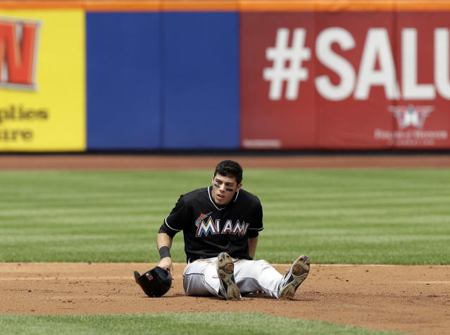 Miami Marlins' Christian Yelich reacts after being caught stealing during the third inning of the baseball game against the New York Mets at Citi Field, Sunday, July 13, 2014 in New York. (AP Photo/Seth Wenig)