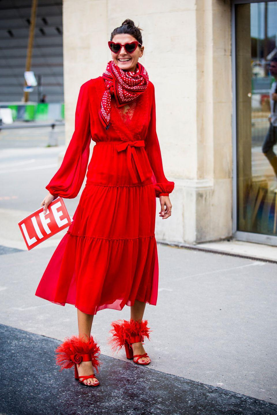 <p>Consider this image the look that cinched red as a major fashion trend for autumn/winter 2017-18. Few are bold enough to wear this vibrant shade from head-to-toe, but Battaglia committed fully, completing her ensemble with a pair of Prada's must-have feather heels.</p>