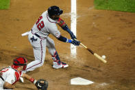 Atlanta Braves' Marcell Ozuna hits an RBI-single off Philadelphia Phillies pitcher Blake Parker during the fifth inning of a baseball game, Sunday, Aug. 30, 2020, in Philadelphia. (AP Photo/Matt Slocum)