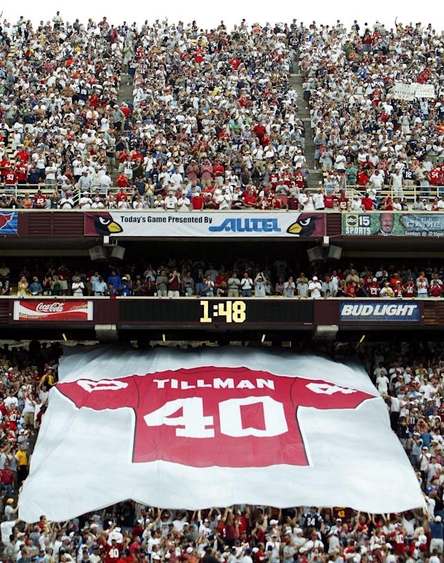A giant #40 jersey is passed down by fans in a half time ceremony honoring the late Pat Tillman, who was killed in military action in Afganistan, during a game between the New England Patriots and the Arizona Cardinals at Sun Devil Stadium on September 19, 2004 in Tempe, Arizona. (Photo by Jeff Gross/Getty Images)