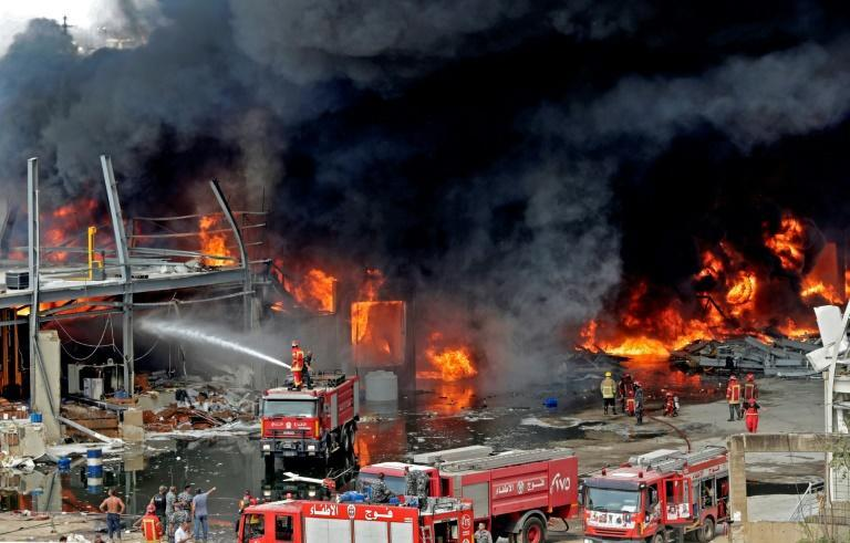 Lebanese firefighters try to put out a fire that broke out at Beirut's port area, on September 10