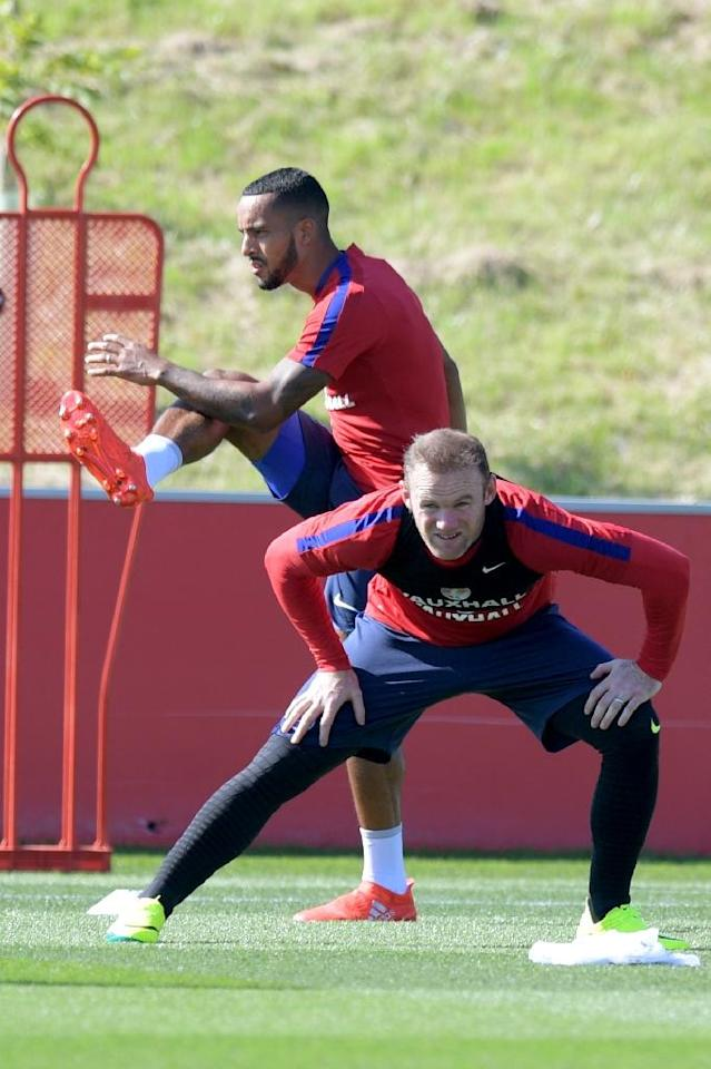 Theo Walcott (left) and Wayne Rooney (right) at an England training session at St George's Park near Burton-Upon-Trent in central England on August 30, 2016 (AFP Photo/Anthony Devlin)
