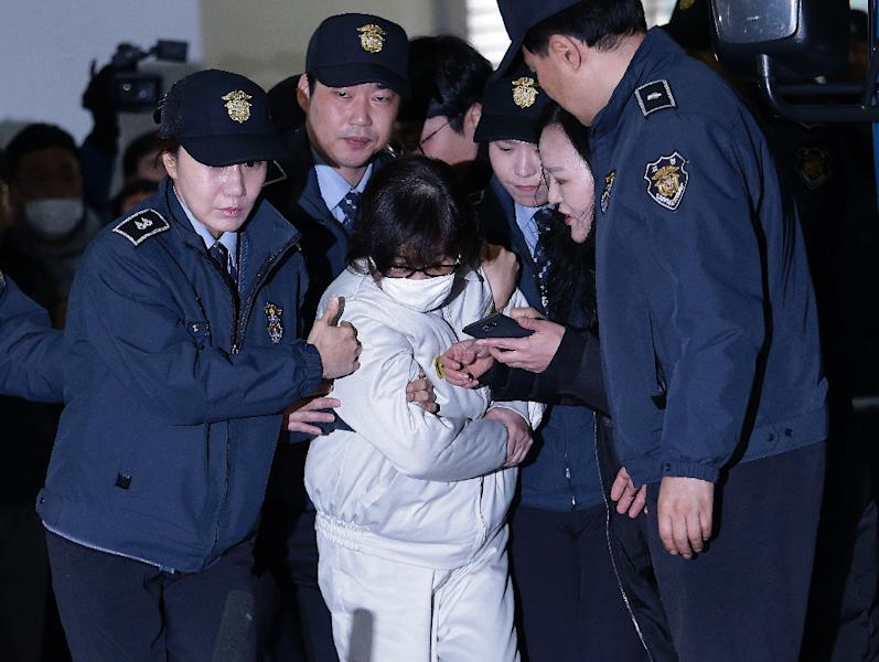 Choi Soon-Sil (C), jailed confidante of South Korean President Park Geun-hye (AFP Photo/AHN Young-Joon)