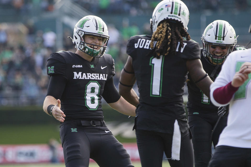 Marshall quarterback Grant Wells (8) celebrates after throwing a touchdown pass to Willie Johnson (1) during the team's NCAA college football game against Middle Tennessee on Saturday, Nov. 14, 2020, in Huntington, W.Va. (Sholten Singer/The Herald-Dispatch via AP)