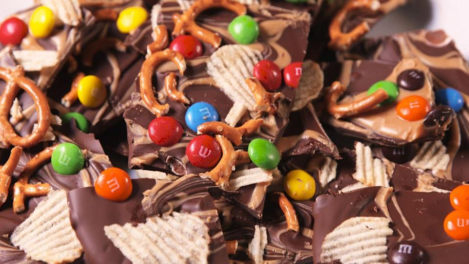 """<p>Chocolate filled with candy, pretzels, and chips? Yes please.</p><p>Get the recipe from <a href=""""https://www.delish.com/cooking/recipe-ideas/recipes/a49184/trash-bark-recipe/"""" rel=""""nofollow noopener"""" target=""""_blank"""" data-ylk=""""slk:Delish"""" class=""""link rapid-noclick-resp"""">Delish</a>.</p>"""