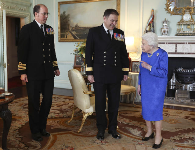 <p>Queen Elizabeth II receives Commodore Steven Moorhouse and Captain Angus Essenhigh during a private audience in Buckingham Palace in London on Wednesday.</p>