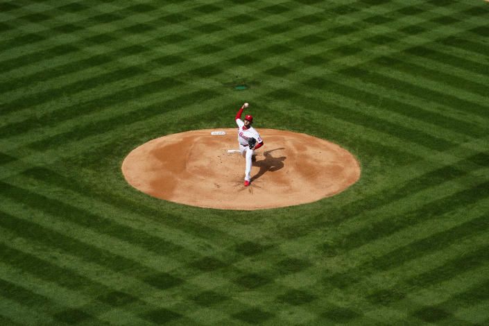 Philadelphia Phillies' Aaron Nola pitches during the first inning of an opening day baseball game against the Atlanta Braves, Thursday, April 1, 2021, in Philadelphia. (AP Photo/Matt Slocum)