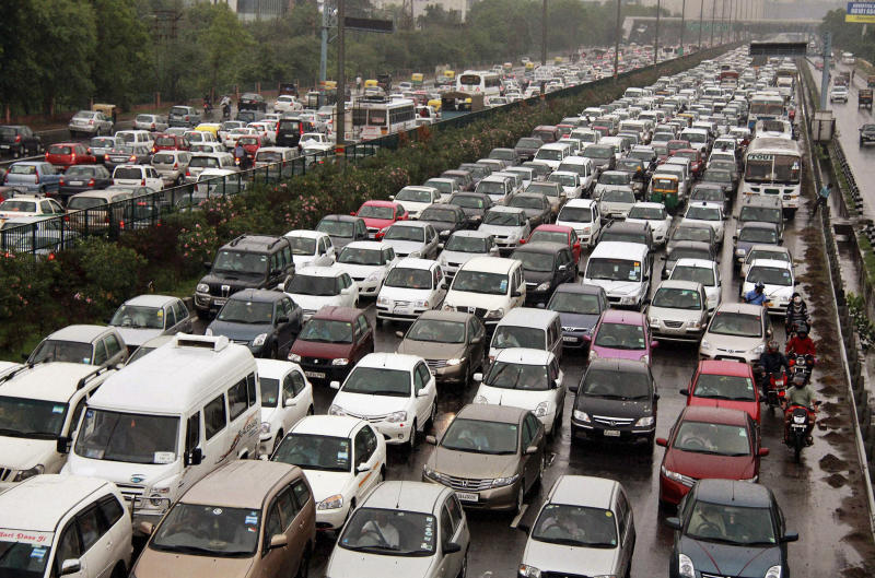 A traffic jam following power outage and rains at the Delhi-Gurgaon road on the outskirts of New Delhi, India, Tuesday, July 31, 2012. India's energy crisis cascaded over half the country Tuesday when three of its regional grids collapsed, leaving 620 million people without government-supplied electricity in one of the world's biggest-ever blackouts. (AP Photo)