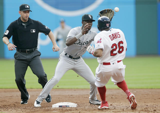 Cleveland Indians' Rajai Davis steals to second base as Chicago White Sox's Tim Anderson waits for the ball in the third inning of a baseball game, Monday, June 18, 2018, in Cleveland. Second base umpire Will Little watches. Davis was safe on the steal. (AP Photo/Tony Dejak)