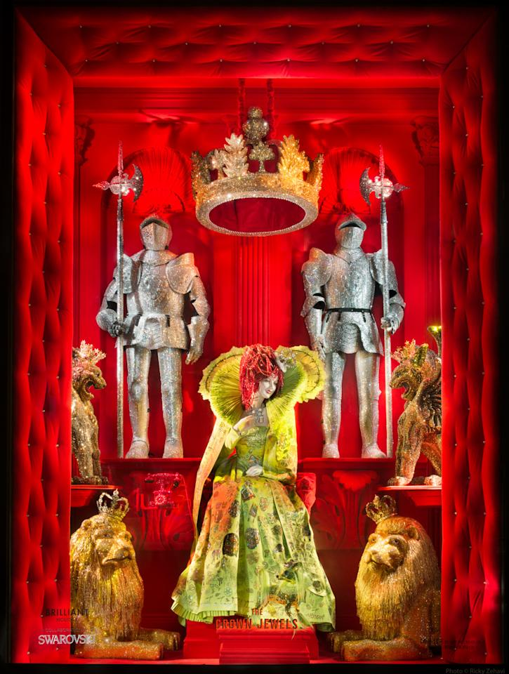 """<p>This year, Bergdorf Goodman collaborated with Swarovski in honor of the crystal giant's 120th anniversary to provide shoppers with a """"Brilliant Holiday."""" This window features sparkling knights, life-size lions, and their glittering queen in a red velvet jewel box.<i>Photo: Ricky Zehavi/ Courtesy </i></p>"""