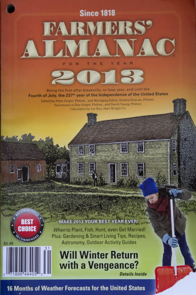 This photo made Thursday, Aug. 23, 2012, shows a copy of the 2013 Farmers' Almanac, published in Lewiston, Maine. The Almanac says people from the Great Lakes to northern New England should get out their long johns and dust off their snow shovels because it's going to be cold and snowy this winter. (AP Photo)