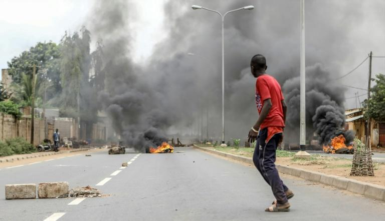 Barricades were burned as anti-government protesters took to the streets in Lome