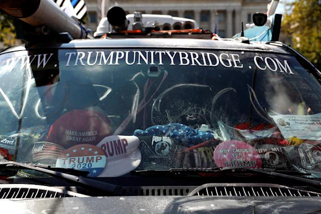<p>'Trump' hats are seen in a vehicle during the Mother of All Rallies demonstration on the National Mall in Washington, Sept. 16, 2017. (Photo: Aaron P. Bernstein/Reuters) </p>