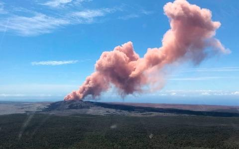 An ash plume rises above the Kilauea volcano on Hawaii's Big Island  - Credit: AFP