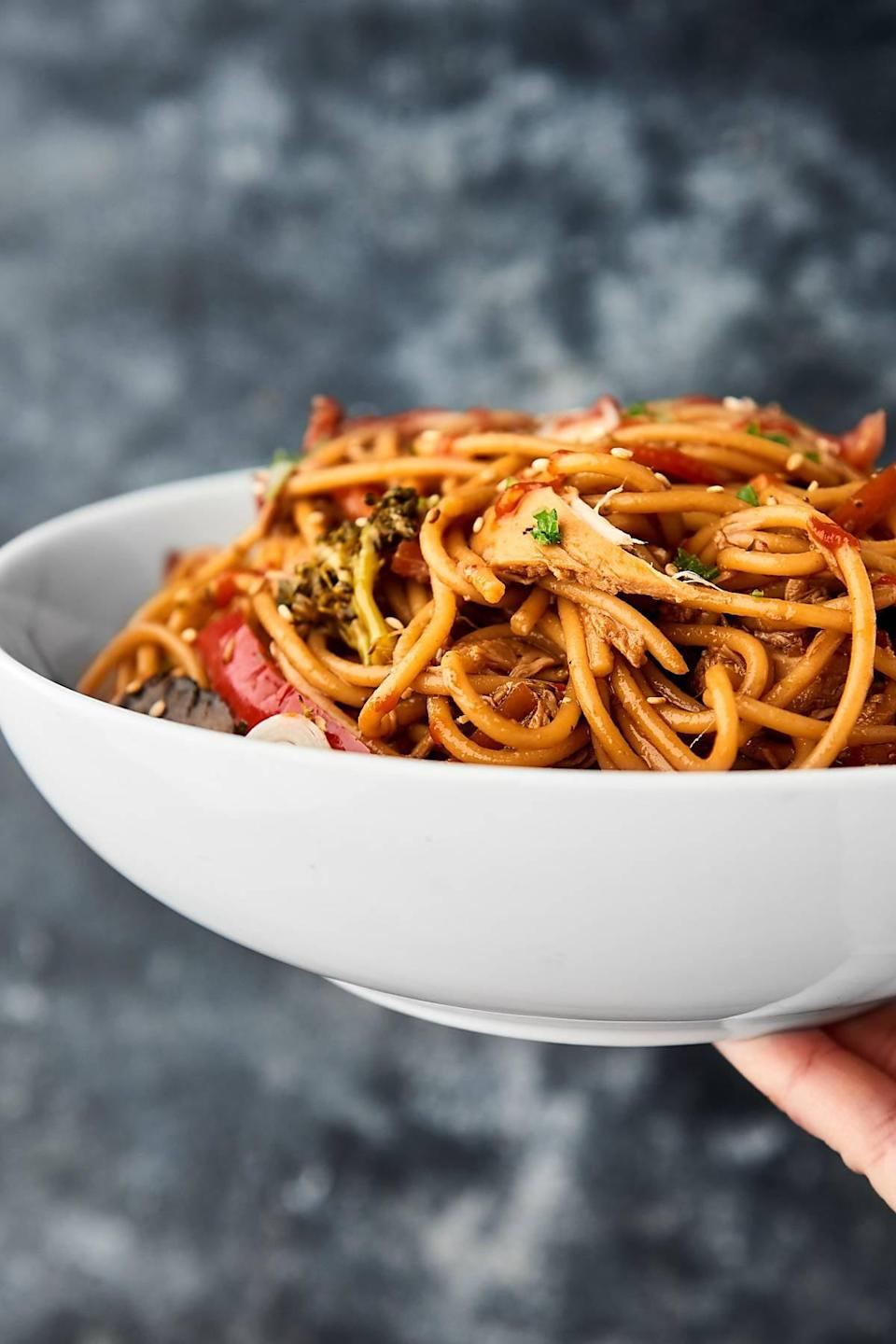 """<p>Craving takeout but not in the mood to go pick it up? This is the recipe for you! It's lighter and healthier than the traditional lo mein, but it still has all the great flavors. The best part about this recipe is that you can easily tweak how many people you want to feed, so if you're serving two, just note it in the recipe and watch as it updates the ingredinet list.</p> <p><strong>Get the recipe:</strong> <a href=""""https://showmetheyummy.com/slow-cooker-lo-mein-recipe/"""" class=""""link rapid-noclick-resp"""" rel=""""nofollow noopener"""" target=""""_blank"""" data-ylk=""""slk:slow-cooker lo mein"""">slow-cooker lo mein</a></p>"""