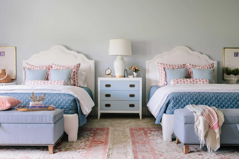 "<p>Layering matching rugs on top of wall-to-wall carpeting defines each bed's space while adding another layer of color and pattern to the room, explains designer <a href=""https://briahammelinteriors.com/"" rel=""nofollow noopener"" target=""_blank"" data-ylk=""slk:Bria Hammel"" class=""link rapid-noclick-resp"">Bria Hammel</a>.</p><p><a class=""link rapid-noclick-resp"" href=""https://go.redirectingat.com?id=74968X1596630&url=https%3A%2F%2Fwww.wayfair.com%2Frugs%2Fsb0%2Farea-rugs-c215386.html&sref=https%3A%2F%2Fwww.goodhousekeeping.com%2Fhome%2Fdecorating-ideas%2Fg770%2Fdecor-ideas-master-bedroom%2F"" rel=""nofollow noopener"" target=""_blank"" data-ylk=""slk:SHOP RUGS"">SHOP RUGS</a></p>"