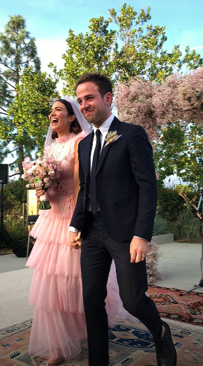 <p>The 'This Is Us' star tied the knot with American musician Taylor Goldsmith wearing a pink, tulle gown by Rodarte. Featuring a ruffled neck and a tiered skirt, the gown was a step away from most traditional white gowns – and suited the 34-year-old perfectly.<em> [Photo: Instagram/Mandy Moore]</em> </p>