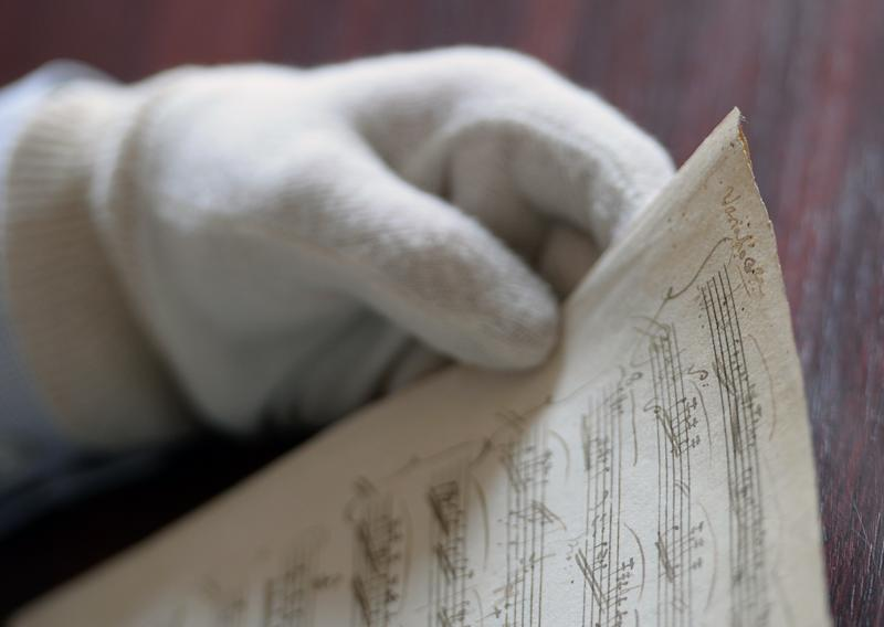 Balazs Mikusi, head of the music collection of the National Szechenyi Library, holds a never before known manuscript of one of the most recognised tunes of Wolfgang Amadeus Mozart, the A major sonata in Budapest on September 17, 2014 (AFP Photo/Attila Kisbenedek)