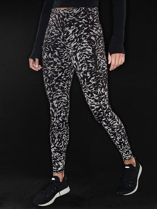 <p>If they like to run at night or before the sun comes up, these <span>Athleta Rainier Reflective Printed Tights</span> ($109) will be a lifesaver.</p>