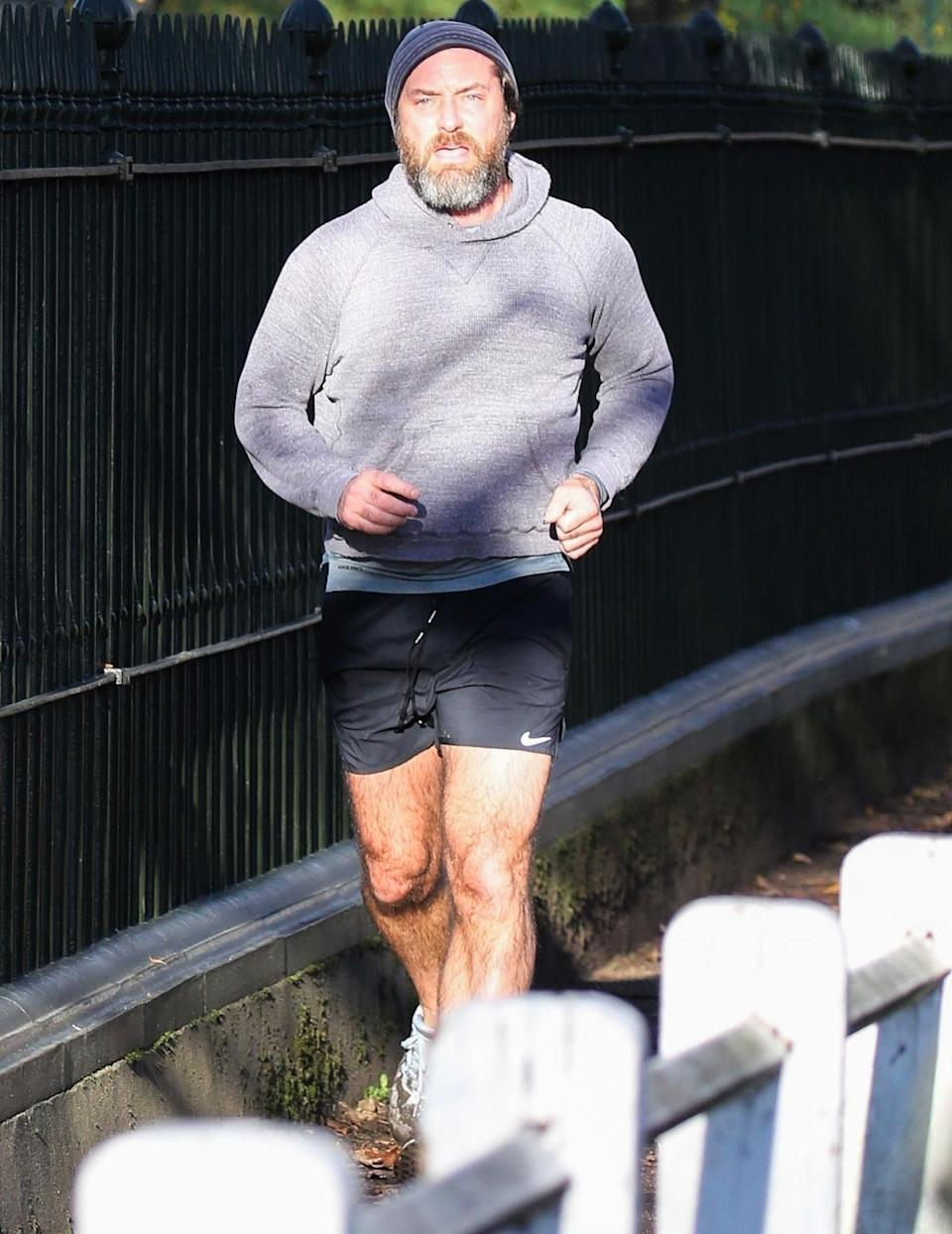 <p>Jude Law works up a sweat while out for a jog near his home in North London on Sunday. </p>