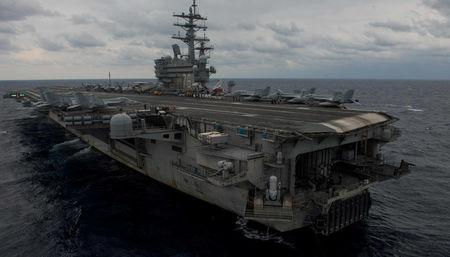 The aircraft carrier USS Ronald Reagan steams the Philippine Sea during Annual Exercise 2017 in this handout photo