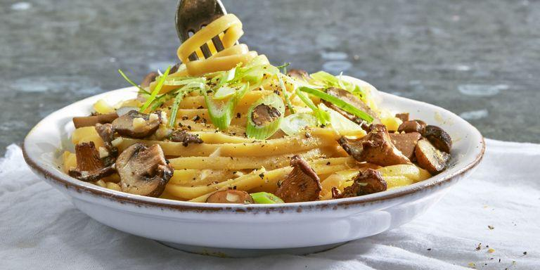 """<p>""""Vegan"""" and """"creamy"""" aren't two words people normally associate with one another, but after trying this linguine you just might change your mind. </p><p><em><strong>Get the recipe from <a href=""""https://www.delish.com/cooking/recipe-ideas/recipes/a45613/creamy-vegan-linguine-with-wild-mushrooms/"""" target=""""_blank"""">Delish.</a></strong></em></p>"""
